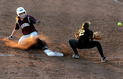 Sarah Nader - snader@shawmedia.com Marengo's Megan Semro (left) slides safely into third after Elmwood Park's  Olga Lipiszko misses the catch during Tuesday's season opener at Judson University on March 13, 2012. Marengo won, 3-1.