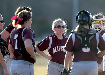 Sarah Nader - snader@shawmedia.com Marengo's Larissa Pfeiffer (center) and the rest of the softball team talk during a time out during Tuesday's season opener at Judson University on March 13, 2012. Marengo won, 3-1.