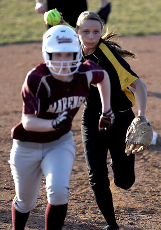 Sarah Nader - snader@shawmedia.com Elmwood Park's  Olga Lipiszko chases after Marengo's Ashley Borhart while she runs to third during Tuesday's season opener against Elmwood Park at Judson University on March 13, 2012. Marengo won, 3-1.