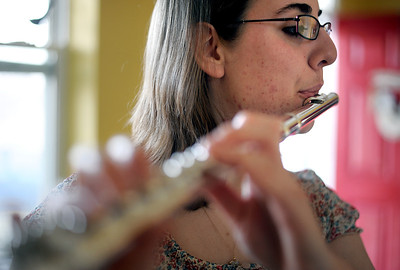 Sarah Nader - snader@shawmedia.com Madeline Bartot, 17, practices a song on her flute while at her home in Huntley on Wednesday, March 14, 2012. Bartot will be performing in the All-National Concert Band ensemble in Washington, D.C. on June 24th.