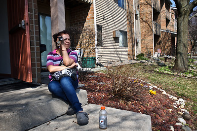 Daniel J. Murphy - dmurphy@shawmedia.com  Francela Amador of Crystal Lake waits to re-enter her apartment to collect personal belongings Thursday March 15, 2012 at Virginia Road Condominiums in Crystal Lake. Francela and her daughter Lisa were rescued from their upper floor balcony by firefighters early Thursday morning when their apartment went up in flames.
