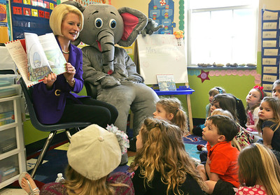 "H. Rick Bamman -hbamman@nwherald.com Callista Gingrich, wife of GOP presidential candidate Newt Gingrich, accompanied by Ellis, a time-traveling elephant, reads to students Thursday morning at the Goddard School in Lake in the Hills as part of a daylong series of campaign visits. Callista, author of children's book ""Sweet Land of Liberty,"" read her book to 4 and 5-year-olds."