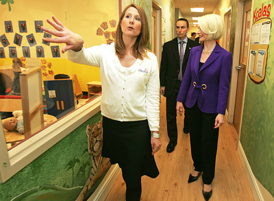 H. Rick Bamman -hbamman@nwherald.com Lake in the Hills Goddard School owner Michele Clark (left) walks with Callista Gingrich as they tour the facility Thursday, Huntley resident Matt McNamara (center) provides security for the Gingrich campaign.