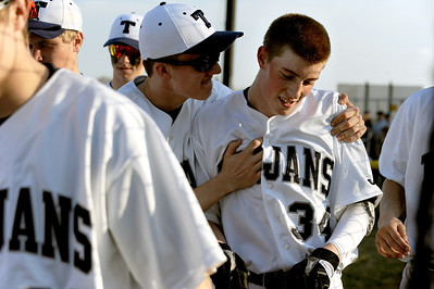 Sarah Nader - snader@shawmedia.com Cary-Grove's Michael Nelson (left) congratulates Cary-Grove's Andrew Brierton after he hit a home run during Thursday's season opener against Fremd in Cary on March 15, 2012. Cary-Grove won, 11-5.