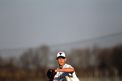 Sarah Nader - snader@shawmedia.com Cary-Grove's Matt Dunlap pitches during Thursday's season opener against Fremd in Cary on March 15, 2012. Cary-Grove won, 11-5.