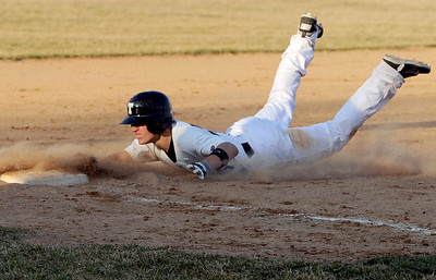 Sarah Nader - snader@shawmedia.com Cary-Grove's Jeremy Vasquez slides safely into third during Thursday's season opener against Fremd in Cary on March 15, 2012. Cary-Grove won, 11-5.
