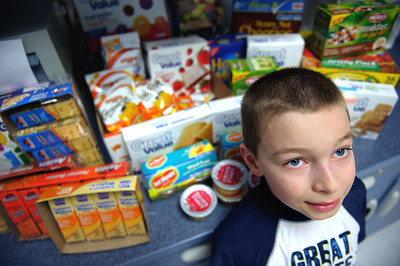 Daniel J. Murphy - dmurphy@shawmedia.com  Crosby Elementary second grader Elijah Davidson, 8, of Harvard recently had a birthday. Instead of presents from his friends he asked for food for the school nurse's office because he knew that sometimes kids were hungry and didn't get enough to eat.