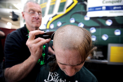 Sarah Nader - snader@shawmedia.com Josh Brent, 15, of Crystal Lake gets his head shaved on Friday at Crystal Lake South High School to raise money for the St. Baldrick's Foundation on March 16, 2012. Brent had a brain tumor in 2005. He's going better, but still has to under go regular blood tests.