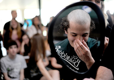 Sarah Nader - snader@shawmedia.com Ryan Olson, 16, of Crystal Lake laughs at his hair while getting his head shaved on Friday at Crystal Lake South High School on March 16, 2012. Participants shaved their heads to raise money for the St. Baldrick's Foundation. The foundation is a volunteer-driven charity that provides funding to find cures for childhood cancers.