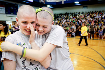 Jenny Kane - jkane@shawmedia.com Woodstock high school freshman Nora Brown, (right) hugs her friend Amanda Jandernoa, (left) after the two had their heads shaved during a St. Baldrick's Foundation fundraiser. Brown's best friend Hope Fuller died of Diffuse Intrinsic Pontine Glioma, March 10, 2010 and would have been a freshman this year at Woodstock high school. St. Baldrick is a charity that raises money for childhood cancer research.