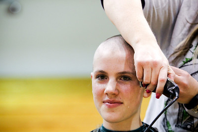 Jenny Kane - jkane@shawmedia.com Kim McKenzie shaves Woodstock high school freshman Amanda Jandernoa's head during a St. Baldrick's Foundation fundraiser in the auditorium of the high school. St. Baldrick is a charity that raises money for childhood cancer research. Jandernoa's aunt died of cancer and she and friend Nora Brown shaved their head together in memory of Hope Fuller. Fuller died of Diffuse Intrinsic Pontine Glioma, March 10, 2010 and would have been a freshman this year at Woodstock high school. Zach Stone raised the most money, netting $2,300 for the organization.