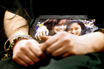 Jenny Kane - jkane@shawmedia.com Woodstock high school freshman Nora Brown holds a photo of herself and her best friend Hope Fuller while she gets her head shaved during a St. Baldrick's Foundation fundraiser in the auditorium of the high school. Fuller died of Diffuse Intrinsic Pontine Glioma, March 10, 2010 and would have been a freshman this year at Woodstock high school. St. Baldrick is a charity that raises money for childhood cancer research. Zach Stone raised the most money, netting $2,300 for the organization.