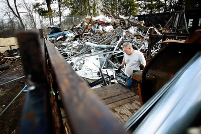 Jenny Kane - jkane@shawmedia.com John Ritzert, of Hebron unloads scrap medal from his truck bed into a pile at St. Behr Iron & Metal in Woodstock.
