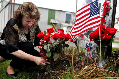 Jenny Kane - jkane@shawmedia.com Mary Olczyk's puts flowers on a memorial for those who lost their life in a mid air military plane explosion that killed 27 men and women on March 19, 1982. Olczyk's husband Army Sgt. Steven Okczyk died in the crash.