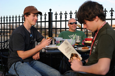 Sarah Nader - snader@shawmedia.com Tony McGivern (center) of Crystal Lake, Andrew Spiniolas, 17, of Lake and the Hills and his brother, Ryan, enjoy dinner on the outdoor patio  at Village Squire in Crystal Lake on Saturday, March 17, 2012.