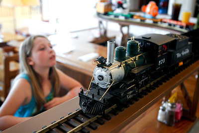 Jenny Kane - jkane@shawmedia.com Madison FitzHenry, 10, of McHenry, looks up at a train that brings food and drinks to her table while eating lunch with her family at the Windhill Pancake Parlor. The resturant has been open in McHenry since 1976.