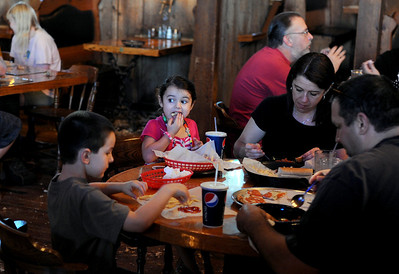 Sarah Nader - snader@shawmedia.com Dan Masciullo (right) of Cary and his family, Tommy, 6, Molly, 4, and Karen all dine at Nick's Pizza & Pub in Crystal Lake on Sunday, March 18, 2012.
