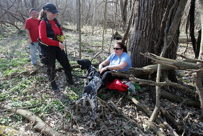 "HandlerJenni Bidner and Liebchen a German short haired pointer of Crystal Lake, find ""lost victim"" Jodie Binder Sunday, March 18, 2012 during a Illinois Wisconsin Search and Rescue Dogs training exercise in Hononegah Forest Preserve near Rockton, Il. Trainee J.J. Bock of South Beloit at left. (AP Photo - Northwest Herald/ H. Rick Bamman) ***CHICAGO LOCALS OUT***"