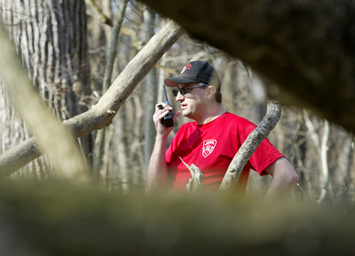 Rob Binder observes a search exercise during the Illinois Wisconsin Search and Rescue Dogs training session Sunday, March 18, 2012  in the Hononegah Forest Preserve near Rockton, Il. (AP Photo - Northwest Herald/ H. Rick Bamman) ***CHICAGO LOCALS OUT***