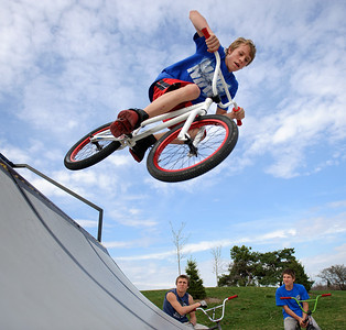 Daniel J. Murphy - dmurphy@shawmedia.com  Jack Bauloun, 15, of Crystal Lake (left) and Kenny Bremer, 14, of Crystal Lake (right) watch Paul Raush, 14, of La Grange perform a bmx trick Monday afternoon March 18, 2012 at Lippold Park in Crystal Lake.