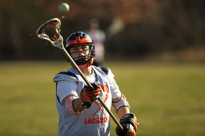 Daniel J. Murphy - dmurphy@shawmedia.com  Crystal Lake Central freshman Zach Armann, 15, secures his helmut for Lacrosse practice Monday March 18, 2012 at Lippold Park in Crystal Lake.   Justin, 16, junior of crystal lake