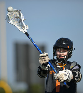 Daniel J. Murphy - dmurphy@shawmedia.com  Crystal Lake Central freshman Zach Armann, 15, secures his helmut for Lacrosse practice Monday March 18, 2012 at Lippold Park in Crystal Lake.  Jim Stephan, 16, So.