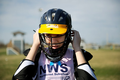 Daniel J. Murphy - dmurphy@shawmedia.com  Crystal Lake Central freshman Zach Armann, 15, secures his helmut for Lacrosse practice Monday March 18, 2012 at Lippold Park in Crystal Lake.