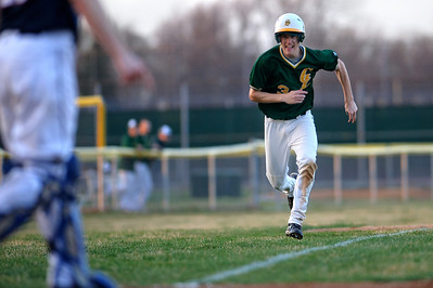 Daniel J. Murphy - dmurphy@shawmedia.com  Crystal Lake out fielder Will Ahsmann #3 sprints towards home plate for the Gators' first run of the game in the seventh inning Monday March 18, 2012 at Crystal Lake South High School in Crystal Lake. Conant defeated Crystal Lake South 3-2.