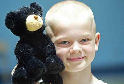 "H. Rick Bamman -hbamman@nwherald.com Eastview Elementary School student Zach Ryza holds Barrett Bear, his first place prize for six year-old boys race last year. The 18th Annual ""Run for the Bear"" - 10K Run and 5K Walk/Run benefits the Bear Necessities Pediatric Cancer Foundation."