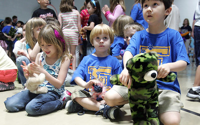 H. Rick Bamman -hbamman@nwherald.com Eastview Elementary School kindergartners from left Taylor Fleury, John Kelly and Isaac Poirier brought Teddy Bears to the Kids Run for the Bear kick off program.