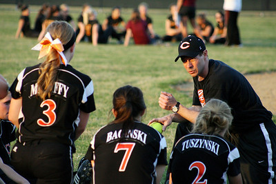 Mike Greene - For the Northwest Herald Crystal Lake Central varsity head coach Brian Strombom speaks with his team after defeating Richmond-Burton 7-6 Monday evening in Crystal Lake.