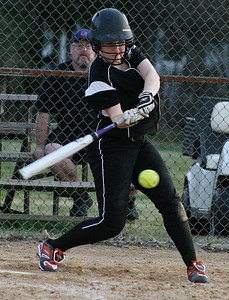 Mike Greene - For the Northwest Herald Crystal Lake Central's Megan Mahaffy drives in the winning runs in the bottom of the 6th inning against Richmond-Burton Monday evening in Crystal Lake. The Tigers defeated the Rockets 7-6.