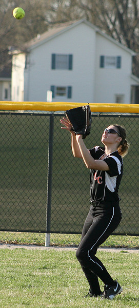 Mike Greene - For the Northwest Herald Crystal Lake Central's Shannon O'Connell prepares to catch a fly ball during a game against Richmond-Burton Monday evening in Crystal Lake. The Tigers defeated the Rockets 7-6.