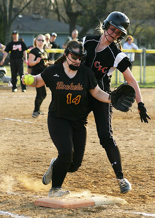 Mike Greene - For the Northwest Herald Crystal Lake Central's Taylor Ward (right) collides with Richmond-Burton's Tawny Ruane at first base Monday evening in Crystal Lake. The Tigers defeated the Rockets 7-6.
