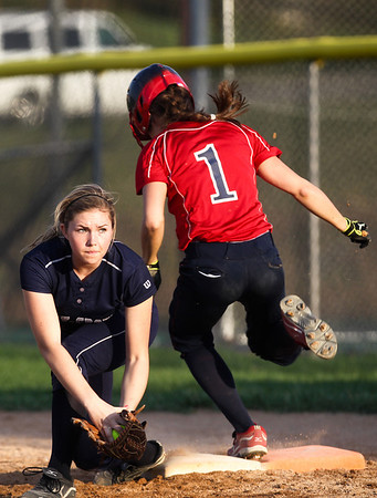 Jenny Kane - jkane@shawmedia.com Tues. March 20, 2012, The Cary-Grove first basemen Megan Leineberg tags Conant's Allie Bauch out at first during the top of the fifth inning. Cary-Grove defeated the Conant's 5-2 at Cary-Grove.