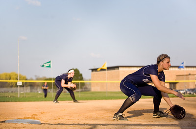 Jenny Kane - jkane@shawmedia.com Tues. March 20, 2012, The Cary-Grove Sara Markelonis waits for the pitch while guarding third base during their game against James B. Conant High School.