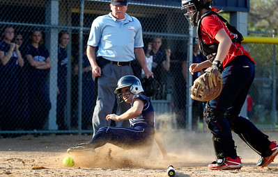 Jenny Kane - jkane@shawmedia.com Tues. March 20, 2012, The Cary-Grove Sara Markelonis slides safely into home during their game against James B. Conant High School.