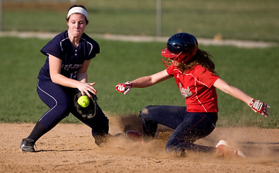 Jenny Kane - jkane@shawmedia.com Tues. March 20, 2012, The Cary-Grove's short stop Jamie Deering tries to make the tag out as Elisa Ambrose slides safely into second during their game at Cary-Grove.
