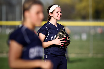 Jenny Kane - jkane@shawmedia.com Tues. March 20, 2012, The Cary-Grove short stop Jamie Deering smiles while waiting for the the pitch during their game against James B. Conant High School.