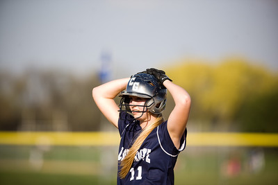 Jenny Kane - jkane@shawmedia.com Tues. March 20, 2012, The Cary-Grove's Lisa Semro waits for the pitch while on first base during their game against James B. Conant High School.