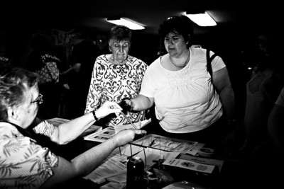 """Lance Booth - lbooth@shawmedia.com Genie Galloway, left and Debbie Filler, both of Woodstock, receive ballots for the primary elections at Hartland Precinct 2 on Tuesday, March 20, 2012. """"Thousands of gave up their lives for this right,"""" said Filler on why she votes."""