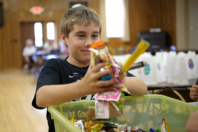 Daniel J. Murphy - dmurphy@shawmedia.com  Bradley Campbell, 9, of Union assembles Easter baskets and that will be donated to food pantries in Harvard and Marengo as well as Turning Point Domestic Violence Agency in Woodstock Wednesday March 21, 2012 in Marengo.
