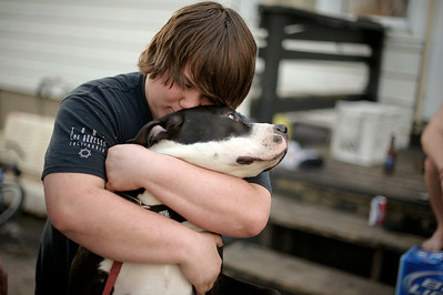 "Daniel J. Murphy - dmurphy@shawmedia.com  Jake Whitson, 18, embraces his dog ""Otis"" in the warm weather outside his home Wednesday afternoon March 12, 2012 in Union."