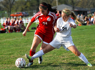 Jenny Kane - jkane@shawmedia.com Prairie Ridge Ali Fanning makes a tackle against Marian Central's Jessica Thome during their non-conference varsity girls soccer game. Prairie Ridge defeated Marian Central 2-0.
