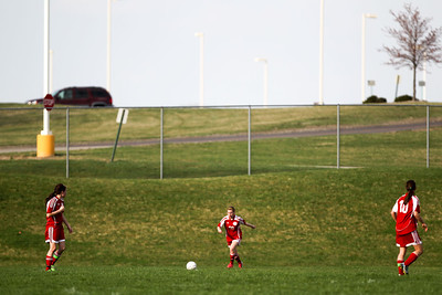 Jenny Kane - jkane@shawmedia.com Marian Central's Megan Hart kicks the ball in during the first half of their non-conference game against Prairie Ridge.