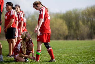 Jenny Kane - jkane@shawmedia.com Marian Central's Abigail Beck ties teammate Robin Wenzel's shoe before their non-conference game against Prairie Ridge.