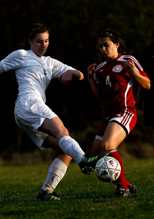 Jenny Kane - jkane@shawmedia.com Prairie Ridge's Kelsey Bear tries to make a tackle against Marian Central's Julia Bennett during their non-conference varsity girls soccer game. Prairie Ridge defeated Marian Central 2-0.