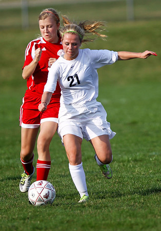 Jenny Kane - jkane@shawmedia.com Prairie Ridge Ali Fanning drives for the ball while defending against Marian Central's Abigail Beck during their non-conference varsity girls soccer game. Prairie Ridge defeated Marian Central 2-0.