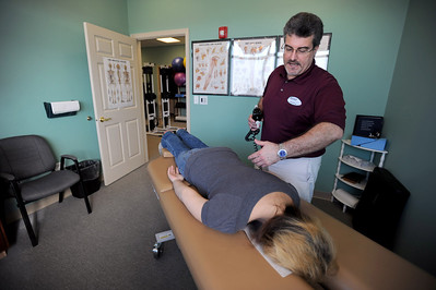 Sarah Nader - snader@shawmedia.com Dr. Bob Hollett adjusts the back of patient Jayme Witz of McHenry at Expert Health and Rehabilitation on Thursday, March 22, 2012. Witz started going to Dr. Hollett six months ago to address back and neck pain that wouldn't go away.