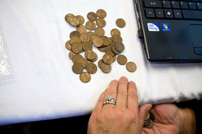 Jenny Kane - jkane@shawmedia.com THR & Associates field buyer Patti Bradwell counts pennies after weighing them during the International Coin Collectors Association's tour at the Hampton Inn in McHenry. THR & Associates offers a chance for locals to sell their gold, silver and coins.